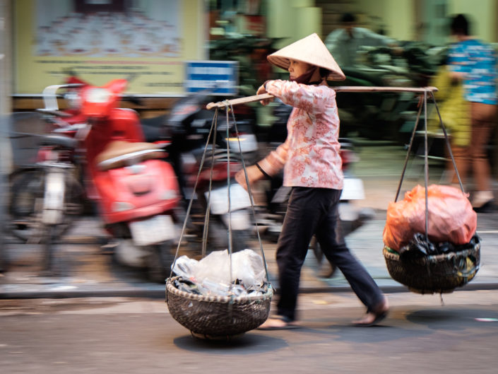Vietnamese woman carrying baskets